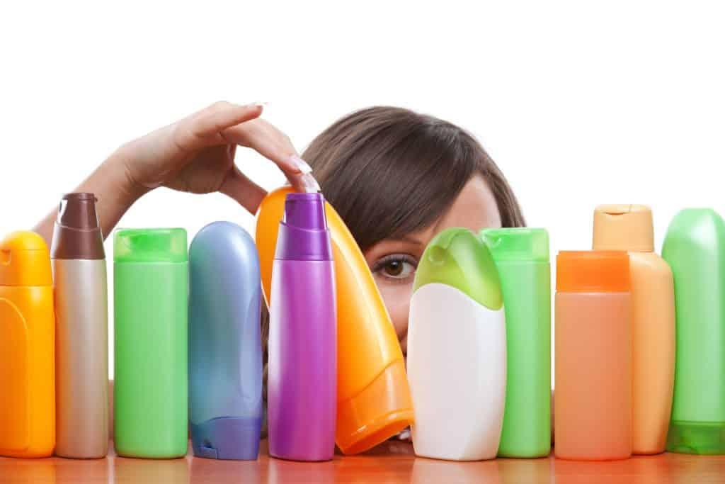woman chooses shampoo