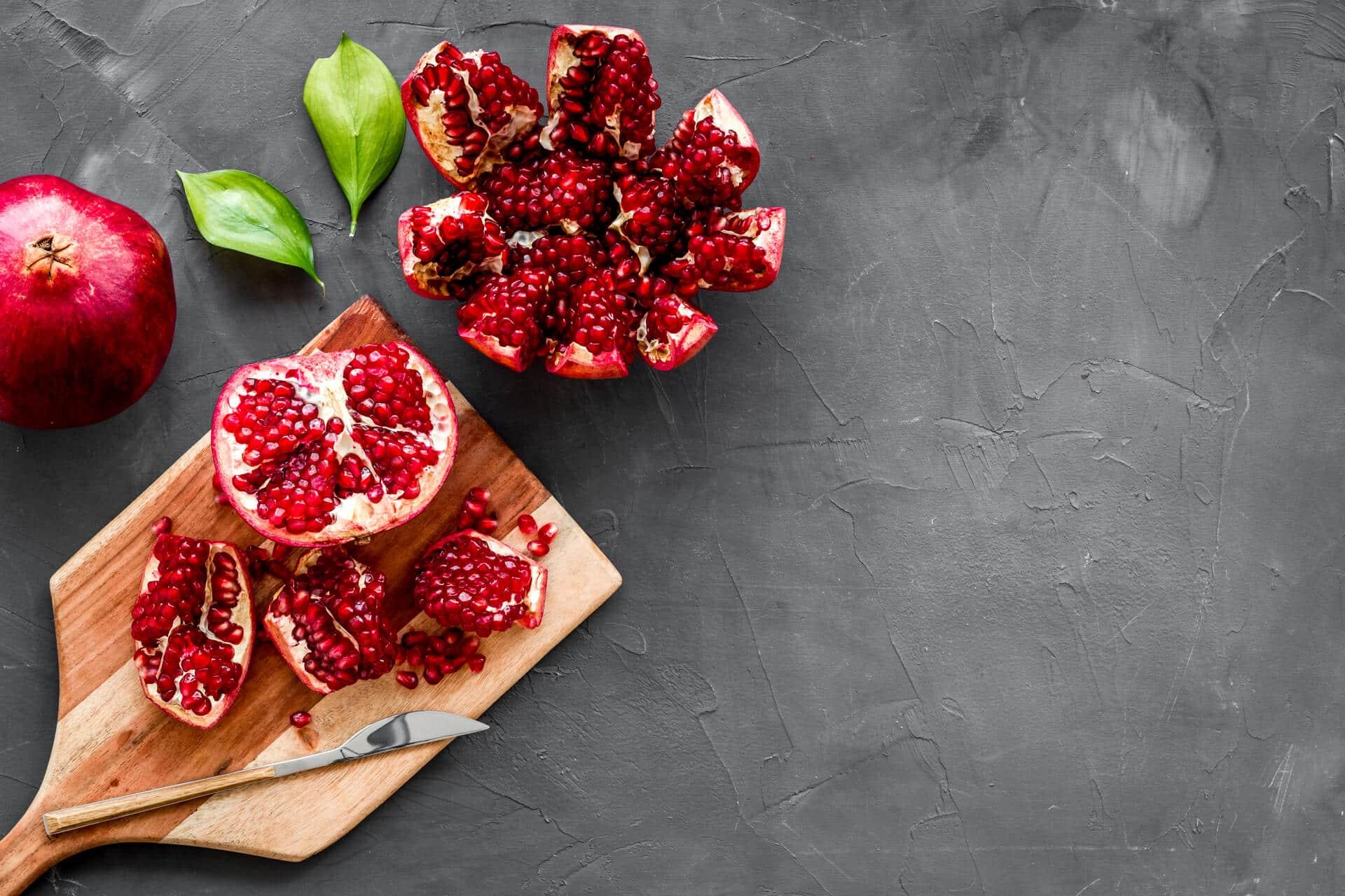 Peel pomegranate on cutting board